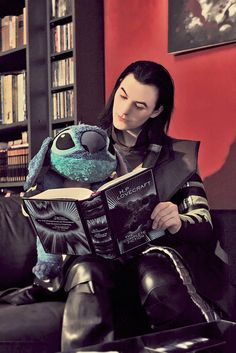 """fahrlight:    """"Now listen well, little one, this is the story of a verymisunderstood fellow named Cthulhu!""""  (Thank you Sarah for the awesome picture and location!)      AAAAAHHHHHHHH  Yes Loki and Stitch, bond over Lovecraft literature. ;u; BOND AND BE FRANDS."""