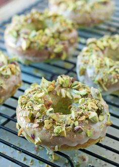 Baked Pistachio Pudding Donuts - Perfect for St. Patrick's Day! Pudding mix makes these amazingly soft and fluffy. www.thelawstudentswife.com #stpatricksday