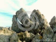 A view of granite spiky rock formation with open cleft at an eastern cape beach in South Africa.