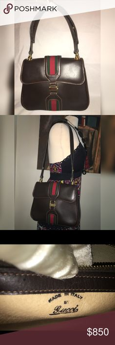 """GUCCI WEB VINTAGE LEATHER SHOULDER HANDBAG 70s Authentic vintage and a rare Classic Gucci design & color. A collectable from the 1970s, only a select few of these handbags can be found. Color is a dark brown. Shoulder straps are interchangeable and can be carried as a satchel and shoulder bag. Inside is very clean and outside edges have some rubbing, but overall vintage condition is impressive. No holes or tears. A classic piece to carry! Measurements are: 11"""" L x 2"""" W x 8"""" H. Strap drop…"""