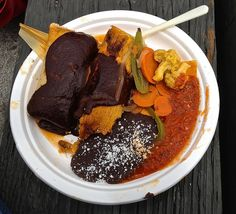pork tamales with mole sauce, side of pickled vegetables and refried black beans from Primavera Mexican Food at Ferry Plaza Farmer's Market in San Francisco