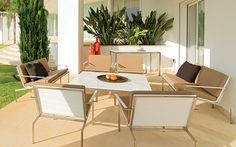 Chaminade Patio Furniture Collection   316 Stainless steel frames   White & sand Corian® colors   100's of Sunbrella cushion colors   Made in Austria