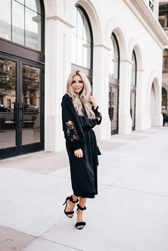 This classic black dress is perfect for all your holiday parties and beyond! The high neck line and embroidered sleeve details are too cute! I am also dying over these heels! LOVE! #fashion #holidayoutfit #shoegoals