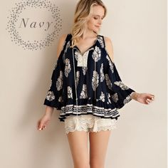 """Summer, Somewhere"" Cold Shoulder Printed Top Cold shoulder printed top with feather prints. Only available in navy. Tassel front. True to size but a loose fit. Brand new. NO TRADES DON'T ASK. Bare Anthology Tops Blouses"