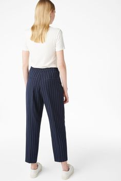Dressy trousers that are meant to have a casual-chic, slightly oversize fit. An elasticized waist in back keeps things in order. Slant pockets in front and