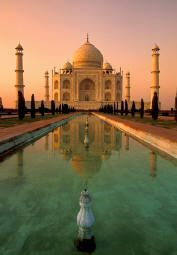 Taj Mahal, India. I want to see this in person with that sunset one day.