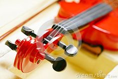 Closeup picture of scroll and pegbox of a red violin. Photo taken on: May 25th, 2013