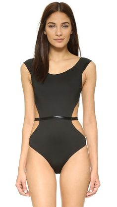 A lustrous band adds subtle sheen to this Fleur du Mal swimsuit. Flirty cutout sides. Lined.