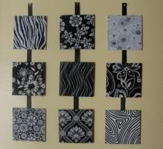 An inexpensive way to decorate a wall - stretch coordinating fabrics over canvas and voila - wall art!