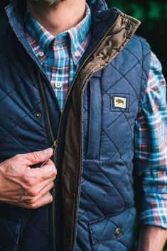 This men's quilted vest is waxed and washed, giving it a broken-in look that still maintains the wax coating. Basically, it's magic. Layers great with an oxford or a flannel, jeans and boots. Also available in camel. Shown here in navy.