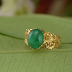 This lovely one of a kind ring has been handmade in our workshops. It features a central cabochon emerald, set in 18ct gold. The ring has exquisite hand engraving work on it using botanical motifs.  The ring is US size O/ USA size 7 1/4.  It can be resized.  Dimensions - 12mm x 10mm  Alternative Wedding Jewellery, Alternative Engagement Rings, Hand Engraving, Anniversary Gifts, Gemstone Jewelry, Emerald, Jewels, Gemstones, Silver