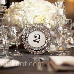 table numbers  displayed in round crystal-studded frames.