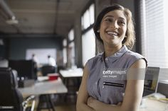 Stock Photo : Smiling businesswoman in office