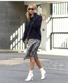 Sock boots are the boot for fall. Pair yours with a flowy, printed skirt and an oversized sweater for a cool, breezy street style outfit.