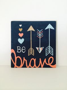 This hand painted Be Brave wood sign is the perfect piece to complement any woodland themed nursery or tribal nursery decor! Also makes a fun, custom and unique baby gift.  Measures approximately 12x 12, 1/2 thick on oak plywood. Colors- navy blue background- coral, light tan, white and light turquoise. Comes ready to hang with a sawtooth hanger on back. Be Brave Wood Sign - Woodland Nursery Wall Art - Baby Girl Room Decor - Arrow Wall Decor - Unique Baby Gift - Tribal Nursery Art - Coral…