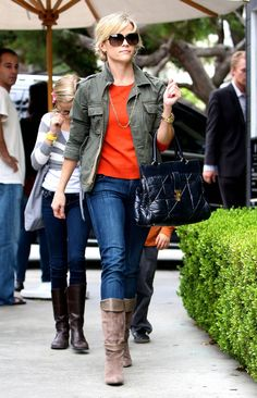 Reese Witherspoon knows how to rock a tangerine top with a cargo jkt and jeans.