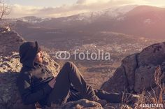Man on top watching a beautiful sunrise in the sunny snowy mount