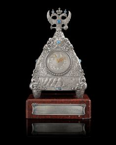 A RARE SILVER FABERGÉ CLOCK, MOSCOW 1908-1917. Imperial Warrant and scratched inventory no 17689.