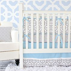 Create a nursery filled with modern design and playful décor. This captivating collection by Caden Lane fuses on-trend lattice and basketweave patterns in the cool colors of blue and grey.