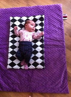 "Lovely newborn on our ""Checkmate"" baby blanet with purple minky! www.laurascircus.com"