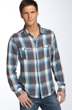 A plaid button up will show your effort in dressing nice for a date.