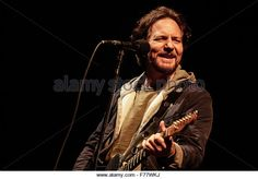 Bogota, Colombia. 26th Nov, 2015. Image taken on Nov. 25, 2015 shows Eddie Vedder, lead singer of the American rock band Pearl Jam, playing a song during the band concert held at Simon Bolivar Park in Bogota city, capital of Colombia, Nov. 26, 2015. © Jhon Paz/Xinhua/Alamy Live News - Stock Image