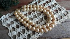 Check out this item in my Etsy shop https://www.etsy.com/listing/484774796/retro-ivory-chunky-pearl-necklace-double