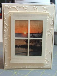 beautiful handmade card: Sunset in the Harbor by cardmaker13 ... window frame die cut from Memory Box ... she printed a photo onto Bazzill paper and got beautiful canvas like texture ... perfect placement of the setting sun ... great card! ...