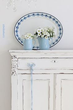 I should do my vintage sewing cabinet all white with light blue stencil...