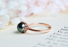 Hey, I found this really awesome Etsy listing at https://www.etsy.com/listing/262436659/black-tahitian-pearl-ring-vintage