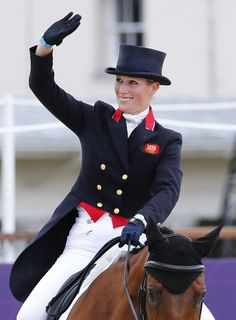 Zara Phillips of Britain riding High Kingdom waves after performing during the equestrian Eventing Individual Dressage Day 2 in the Greenwich Park during the London 2012 Olympic Games