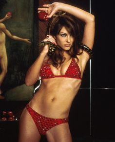 ELIZABETH HURLEY Bedazzled, 2000  Elizabeth Hurley starred in the 2000 remake of the 1967 film Bedazzled which is a comedic retelling of the classic Faust deal-with-the-devil legend. Hurley embraced her diabolical role and donned a (literally) bedazzled red bikini that we'd sell our souls for.