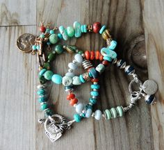Artisan Jewelry, Multi Colored Gemstone Bracelet, Thai Silver Beads, Layering Bracelet, Stacking Bracelet, Rustic Handcrafted, Southwestern  This artisan bracelet has all the colors of a fiesta in its gemstones - pale green variscite, bright orange/red apple coral, dark blue rounds of kyanite, and pale blue faceted roundels of extremely rare Owyhee opals. Each stone is flanked by either Thai sterling silver bead caps, brushed disk spacers or smooth round beads. It closes with a large…