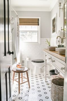 A kids' bathroom gets a clean and classic refresh using these simple inexpensive black and white bathroom decor swaps. Coffee Table Vignettes, Decorating Coffee Tables, White Bathroom Decor, Simple Bathroom, Home Decor Items, Diy Home Decor, Bathroom Canisters, Modern Farmhouse Bathroom, Wooden Stools