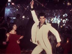 """IlPost - John Travolta in una scena del film """"La febbre del sabato sera"""", del 1977 (AP Photo/HO) - John Travolta in una scena del film """"La febbre del sabato sera"""", del 1977 (AP Photo/HO)"""
