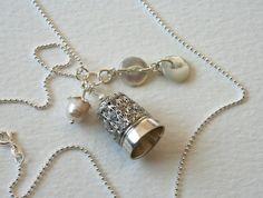 Vintage thimble and antique button charm necklace.