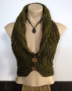 Lovely moss green crochet vest, with coconut buttons Made with soft acrylic yarn :) Please tell me your size when you order :)  All items are