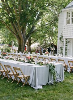 Long tables w/ white table cloths + garland -- double stacked