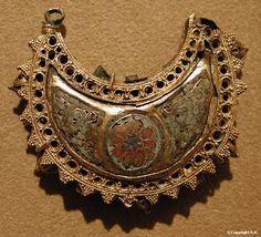 Russian crescent shaped silver gilt earrings with cloisonné rosettes, 12th century