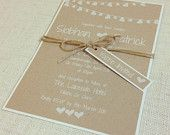 Boho Chic wedding invitation with printed heart bunting feature, twine & tag, in white ink