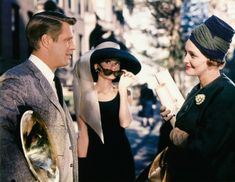 Audrey Hepburn,George Peppard and Patrica Neal in Breakfast at Tiffany's.   🌹