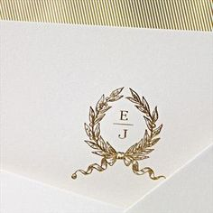Hand Engraved Officer's Club Ball Invitation: Our classic engraved monogram wreath in elegant gold paired with navy blue ink on this pearl white invitation sets the tone for a stately affair brimming with equal parts polish and cheer.