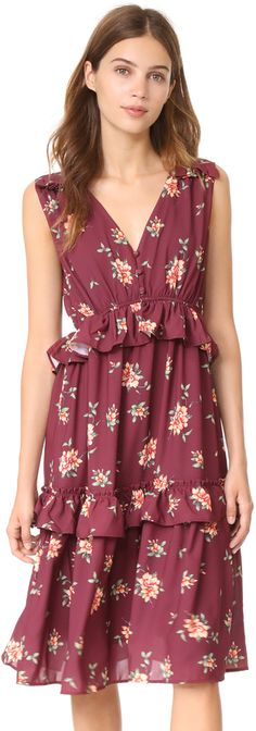 This burgundy floral Ella Moon midi dress is detailed with flounced ruffles. A trio of buttons secures the partial placket below the deep V neckline, and covered elastic defines the waist. Sleeveless. Hidden back zip. Lined. Affiliate Link