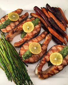 Tonight we enjoyed grilled salmon steaks with a lemon, cilantro, basil & pumpkin seed pesto. Served with roasted heirloom carrots, asparagus and some garlic butter rice. Have a nice evening! @zimmysnook