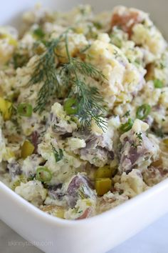 This creamy potato salad made with rainbow potatoes, celery, pickles, mustard and dill is lightened up using half mayonnaise, half yogurt. Perfect for picnics and backyard parties all summer long.