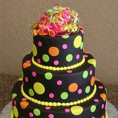 neon polka dot cake? mwahaha all it needs is a skull with a bow at the top, and some bright blue and purple.