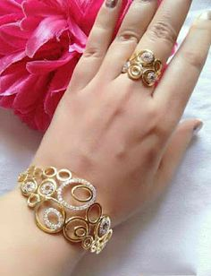 Golden bracelet and ring sets Gold Ring Designs, Gold Bangles Design, Gold Jewellery Design, Bridal Bangles, Bridal Jewelry, Garnet Jewelry, Gold Jewelry, Antique Jewelry, Gold Fashion