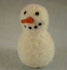 My aunt, cousin, and I are on a mission to learn how to felt!  I can't wait!  Needle Felted Snowman Tutorial