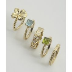 Beyond Rings Set of 5 - gold and stone flower rings ($47) ❤ liked on Polyvore