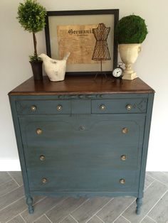 Annie Sloan Chalk Paint - 50/50 mix of Aubusson Blue & Graphite. Finished with dark wax. Stained top in Jacobean.